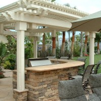 Flagstone counters and patio covers are perfect additions to your backyard..