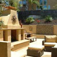 Outdoor living area with Waterwall and Fireplace