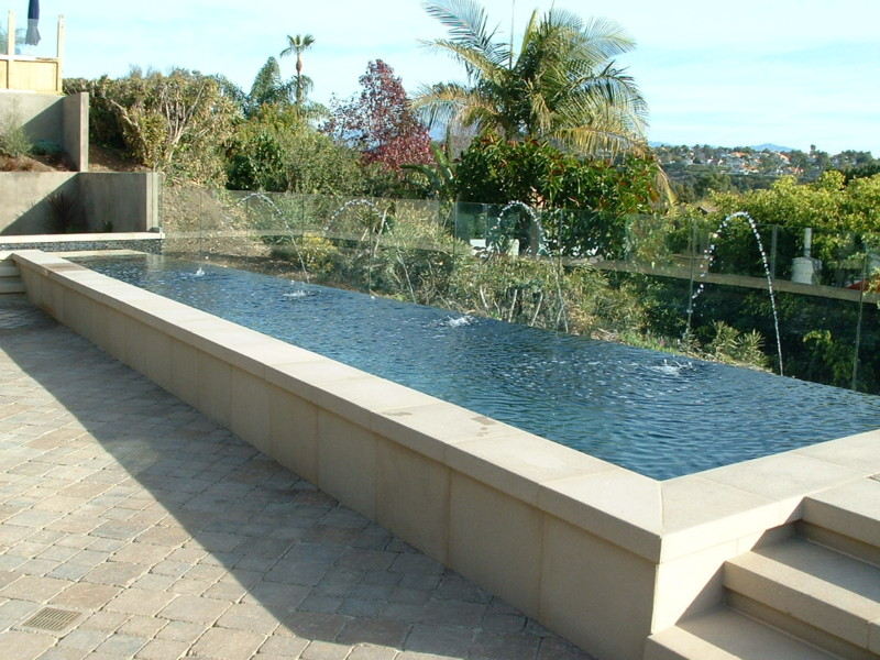 Captivating Precast Concrete Coping And Raised Wall Clading And Steps. Belgard Paver  Decking. Pool Is