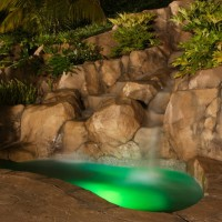 Come on in to a heated spa and warm waterfall.