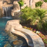Gold quartzite swim up counter with in-pool stools.