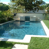 Rectangular design with travertine coping, 2' raised spa, pebble interior finish