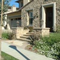 Tuscan Entry with lighting is a way to spruce up your homes curb appeal.