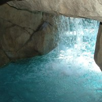"""View from walk-in or swim-in cave. Water depth is 16"""" inside cave with color night lighting, music speakers, and dry bench seat."""