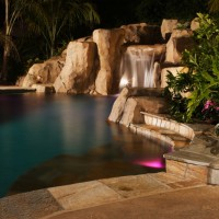 Swim out with bar stools and small counter. Quartzite coping and tile.