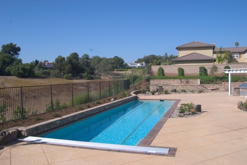 Lap Pool With Auto Cover Bullnose Bricks Raised Back Pool Wall San Diego Swimming Pool