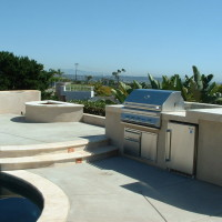 Lighted deck steps, complete BBQ cooking area.