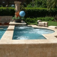 Raised Spa with travertine coping and sides.