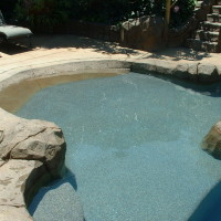 Beach entry and large baja landing added to a remodeled pool.