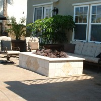 4' x 6' raised firepit with Viejo bullnosed Travertine. Decking is Davis color Yosemite brown.