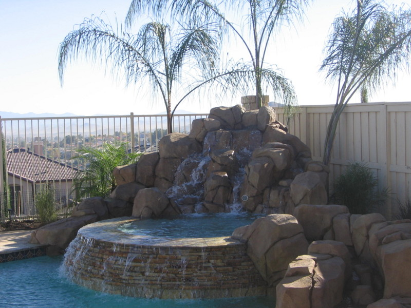 Raised Spa With Quartzite Coping And Natural Boulders San Diego Swimming Pool Builders San
