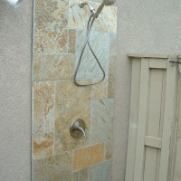 Hot/cold Quartzite shower with stainless hardware.