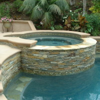 Raised Spa with stacked quart and spill wall