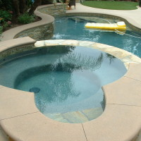 Spa with poured in place colored concrete coping