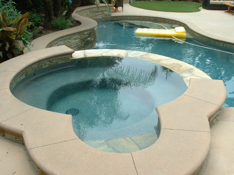 Spa With Poured In Place Colored Concrete Coping San