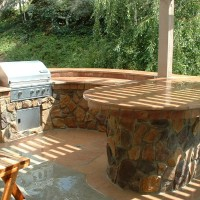 Flagstone counters and stone faced side walls for that natural flow.
