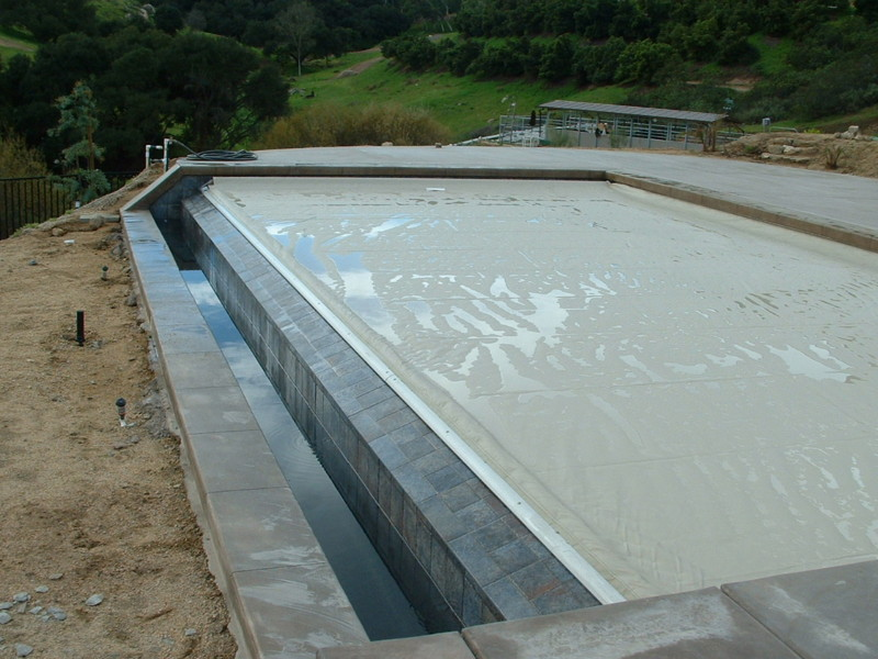 Automatic Pool Cover Track Is Mounted To The O Edge Spiilwall San Diego Swimming Pool