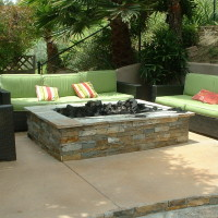 Fire pit with stacked ledger quartz and quartzite cap
