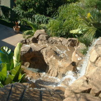 Cascading waterfalls and lush landscapes bring your dream vacation to your own backyard