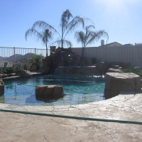 Small artificial rock pool and spa with landscape boulders, Spa waterfall, baja landing.