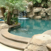 Tropical paridise with artificial rock waterfall and slide