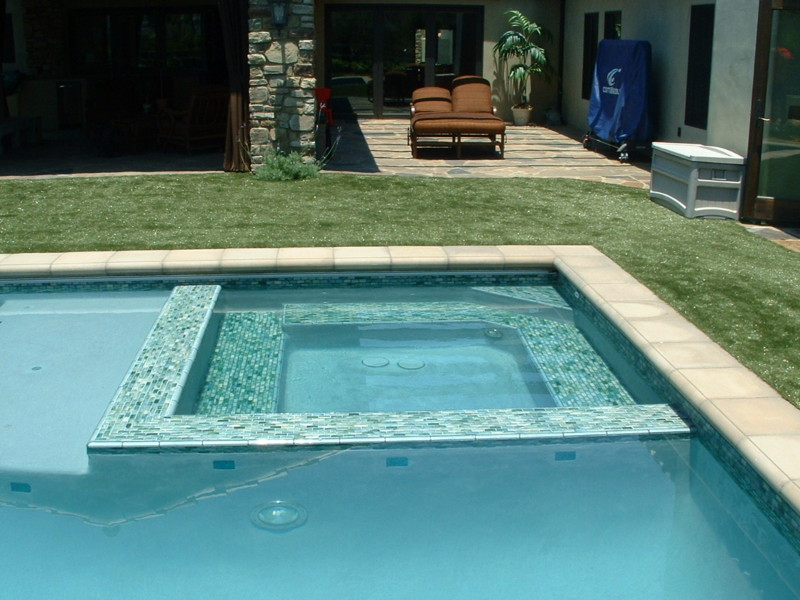 Tile Around Pool : Glass tile spa wall steps and benches artificial turf