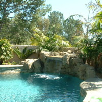 Smaller waterfalls fit into almost any space and provide lots on fun with the shorter jumping boulders, waterfall, and swim in grotto with love seat.
