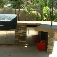 BBQ/ Counter with poured in place counter and stacked quartz veneer sides.