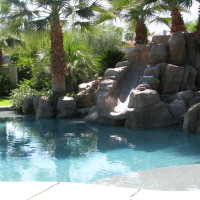 Freestanding slide and waterfall blending into it's surroundings