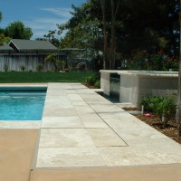 "24"" walk-on lid trays covered with travertine to hide the Pool Safe Automatic cover"