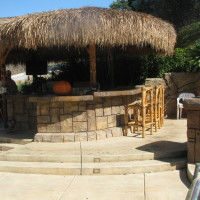Acid stained concrete rock-textured and sealed. Thatched palapa
