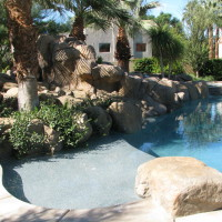 Secluded baja landing and lush landscaping with accent boulders.