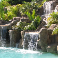 Cascading waterfalls, lush landscape planters, slides and caves.
