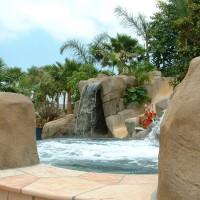 Artificial rock boulders with Arizon flagstone. Slide, grotto, jumping rocks.