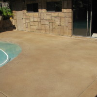 What to do with existing grey concrete decking.  Acid stains in multiple colors change this grey concrete to a more natural color.