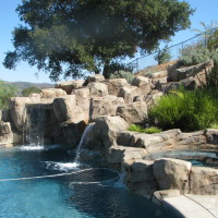 when you want a waterfall you almost need to add a water slide. this manmade rock is a nice addition to the design.