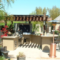 BBQ and Counter bar with granite counter tops, quartzite TV enclosure, patio cover.