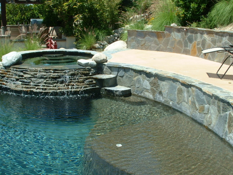 Stacked quartz ledger spa wall and steps down to dual for Swimming pool design xls