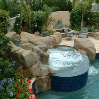 Tile spa and artificial rock boulders