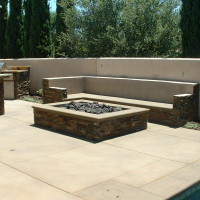 5' x 7' firepit and masonry seatwall with stacked quartz ledger panels. Column counter bar.