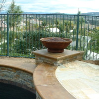 Fire Bowl with Eco glass on stacked quartz/ poured in place concrete column.