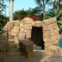 Lighted steps up to the artificial faux rock waterslide. Walk-in cave/grotto with loveseat and baja landing. Cascading waterfall and jumping boulders. Pool is 8' deep.