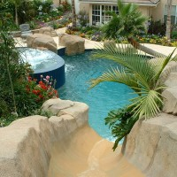 View from 15' rock waterslide and jumping rocks. Description : Artificial rock waterslide, grotto, waterfall.