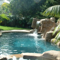 18LF x 7' tall waterslide buffed and epoxy coated. Adjustable valve controls slide/waterfall volume. Upper catch pool above waterfall. Walk-in cave to grotto and baja landing.