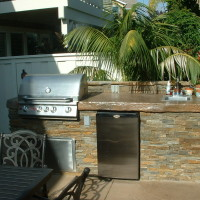 Stacked quartzite BBQ with poured in place rock textured counter top w/glossy sealer.