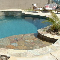 """shallow baja shelf capped with plum quartzite with umbrella stand. Layout with your lounger, read a book, and relax, the water's only 6"""" deep."""