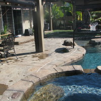 Rock textured concrete decking acid stained with multiple colors.