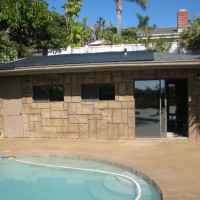 What to do with the old pool room?? Converted into a rock textured concrete cabana that blends with its surroundings
