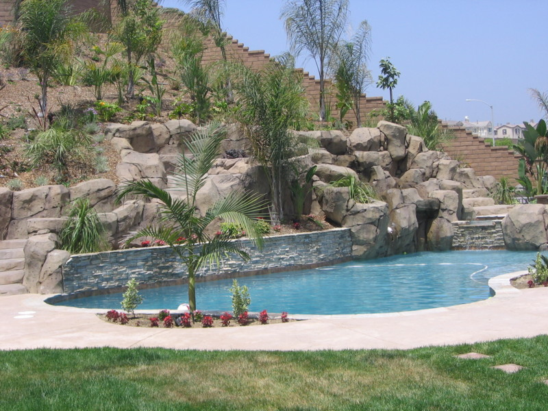 Freeform Rock Pool With Stacked Quartzite Artificial Rock Waterfall And Slide San Diego
