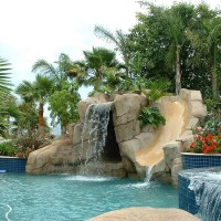 Waterslide and grotto with 6' high jumping rocks.